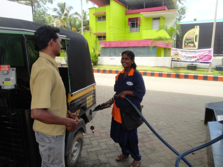 My rickshaw-wala and lady at petrol pump sharing local gossip!