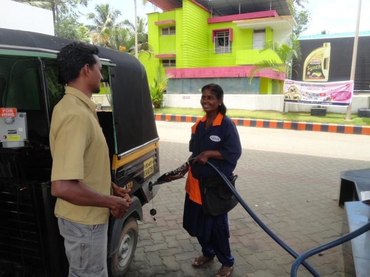 My rickshaw-wala and lady at petrol pump sharing local gossip!