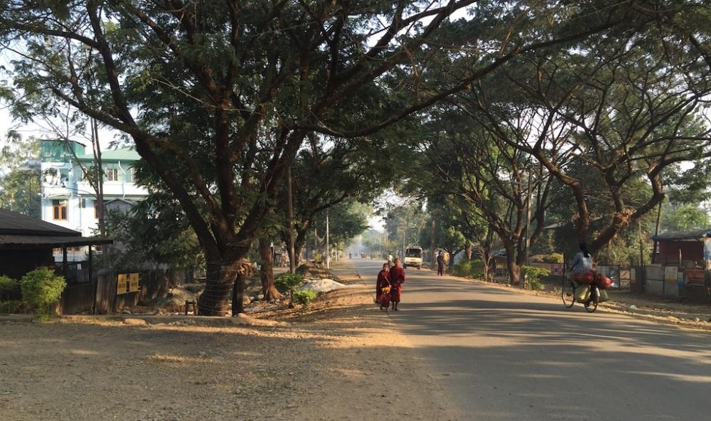 Little monks in Tamu, going around for morning elms.